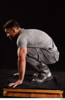Larry Steel  1 boots dressed grey camo trousers grey t shirt kneeling shoes whole body 0003.jpg