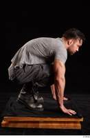 Larry Steel  1 boots dressed grey camo trousers grey t shirt kneeling shoes whole body 0007.jpg