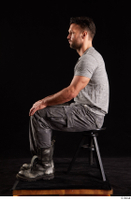Larry Steel  1 boots dressed grey camo trousers grey t shirt shoes sitting whole body 0001.jpg