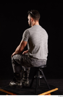 Larry Steel  1 boots dressed grey camo trousers grey t shirt shoes sitting whole body 0002.jpg