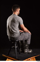Larry Steel  1 boots dressed grey camo trousers grey t shirt shoes sitting whole body 0004.jpg