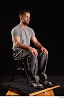 Larry Steel  1 boots dressed grey camo trousers grey t shirt shoes sitting whole body 0006.jpg