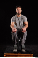 Larry Steel  1 boots dressed grey camo trousers grey t shirt shoes sitting whole body 0007.jpg