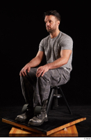 Larry Steel  1 boots dressed grey camo trousers grey t shirt shoes sitting whole body 0008.jpg