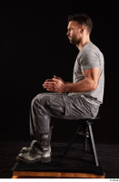 Larry Steel  1 boots dressed grey camo trousers grey t shirt shoes sitting whole body 0009.jpg