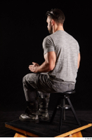 Larry Steel  1 boots dressed grey camo trousers grey t shirt shoes sitting whole body 0010.jpg