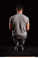 Larry Steel  1 boots dressed grey camo trousers grey t shirt shoes sitting whole body 0011.jpg