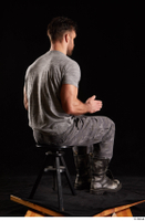 Larry Steel  1 boots dressed grey camo trousers grey t shirt shoes sitting whole body 0012.jpg