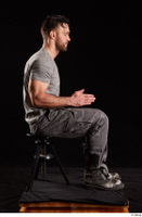 Larry Steel  1 boots dressed grey camo trousers grey t shirt shoes sitting whole body 0013.jpg