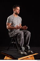 Larry Steel  1 boots dressed grey camo trousers grey t shirt shoes sitting whole body 0014.jpg