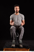 Larry Steel  1 boots dressed grey camo trousers grey t shirt shoes sitting whole body 0015.jpg
