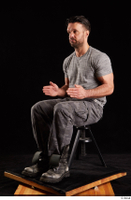 Larry Steel  1 boots dressed grey camo trousers grey t shirt shoes sitting whole body 0016.jpg