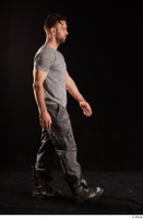 Larry Steel  1 boots dressed grey camo trousers grey t shirt shoes side view walking whole body 0001.jpg