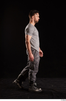 Larry Steel  1 boots dressed grey camo trousers grey t shirt shoes side view walking whole body 0002.jpg