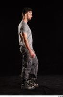 Larry Steel  1 boots dressed grey camo trousers grey t shirt shoes side view walking whole body 0003.jpg