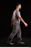 Larry Steel  1 boots dressed grey camo trousers grey t shirt shoes side view walking whole body 0005.jpg