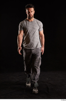 Larry Steel  1 boots dressed front view grey camo trousers grey t shirt shoes walking whole body 0005.jpg