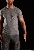 Larry Steel  1 arm dressed flexing front view grey t shirt 0001.jpg