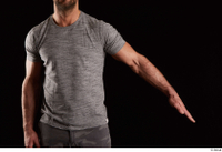 Larry Steel  1 arm dressed flexing front view grey t shirt 0002.jpg