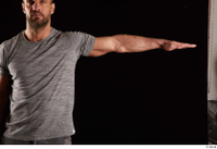 Larry Steel  1 arm dressed flexing front view grey t shirt 0003.jpg