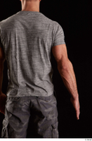 Larry Steel  1 arm back view dressed flexing grey t shirt 0001.jpg