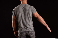 Larry Steel  1 arm back view dressed flexing grey t shirt 0002.jpg