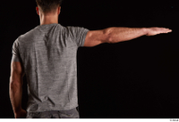 Larry Steel  1 arm back view dressed flexing grey t shirt 0003.jpg