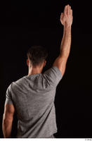 Larry Steel  1 arm back view dressed flexing grey t shirt 0005.jpg