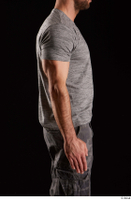 Larry Steel  1 arm dressed flexing grey t shirt side view 0001.jpg
