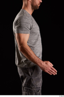 Larry Steel  1 arm dressed flexing grey t shirt side view 0002.jpg