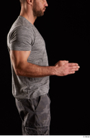 Larry Steel  1 arm dressed flexing grey t shirt side view 0003.jpg