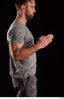 Larry Steel  1 arm dressed flexing grey t shirt side view 0004.jpg