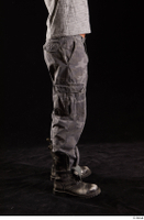 Larry Steel  1 boots dressed flexing grey camo trousers leg shoes side view 0001.jpg