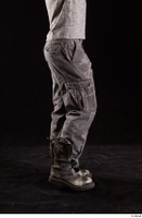 Larry Steel  1 boots dressed flexing grey camo trousers leg shoes side view 0002.jpg