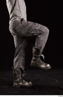 Larry Steel  1 boots dressed flexing grey camo trousers leg shoes side view 0004.jpg