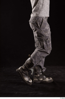 Larry Steel  1 boots calf dressed flexing grey camo trousers shoes side view 0001.jpg