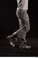 Larry Steel  1 boots calf dressed flexing grey camo trousers shoes side view 0002.jpg