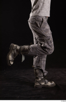 Larry Steel  1 boots calf dressed flexing grey camo trousers shoes side view 0003.jpg