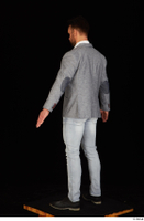 Larry Steel black shoes business dressed grey suit jacket jeans standing white shirt whole body 0012.jpg