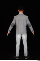 Larry Steel black shoes business dressed grey suit jacket jeans standing white shirt whole body 0013.jpg