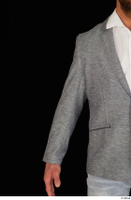 Larry Steel arm business dressed grey suit jacket upper body 0001.jpg
