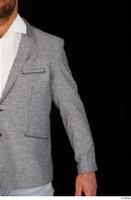 Larry Steel arm business dressed grey suit jacket upper body 0002.jpg