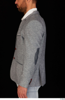 Larry Steel arm business dressed grey suit jacket upper body 0003.jpg