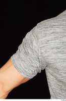 Larry Steel arm casual dressed grey t shirt upper body 0001.jpg