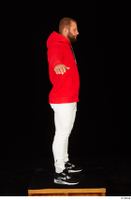 Dave black sneakers dressed red hoodie standing white pants whole body 0023.jpg