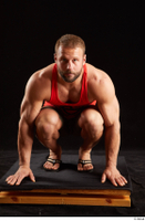 Dave  1 camo shorts dressed kneeling red tank top sandals whole body 0001.jpg