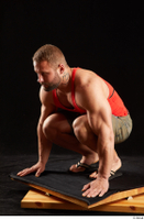 Dave  1 camo shorts dressed kneeling red tank top sandals whole body 0002.jpg