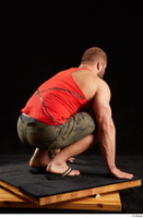 Dave  1 camo shorts dressed kneeling red tank top sandals whole body 0006.jpg