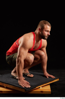 Dave  1 camo shorts dressed kneeling red tank top sandals whole body 0008.jpg