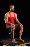 Dave  1 camo shorts dressed red tank top sandals sitting whole body 0006.jpg